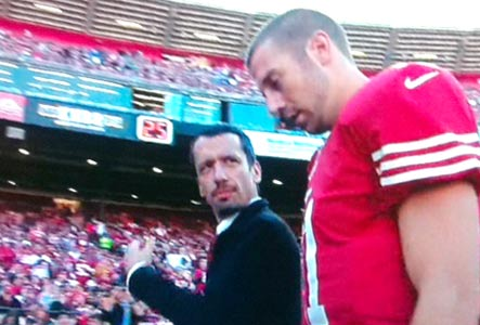 Dr. Dan Garza escorts QB Alex Smith to the locker room